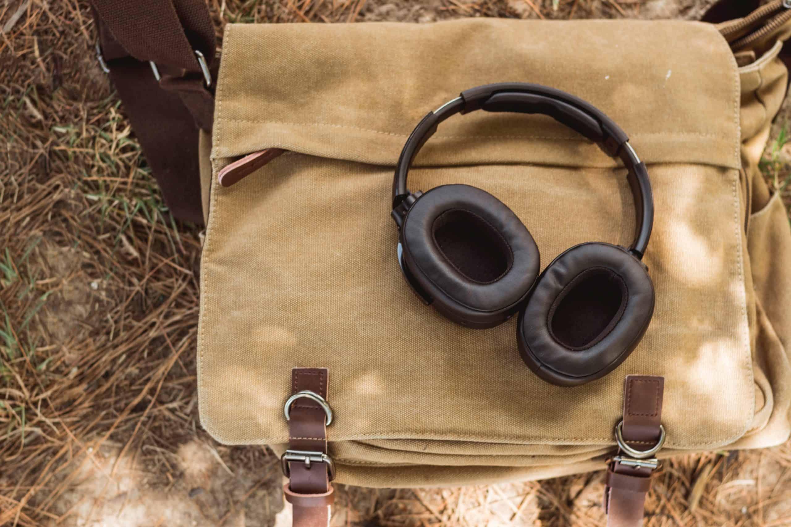 wireless headphones on shoulder bag