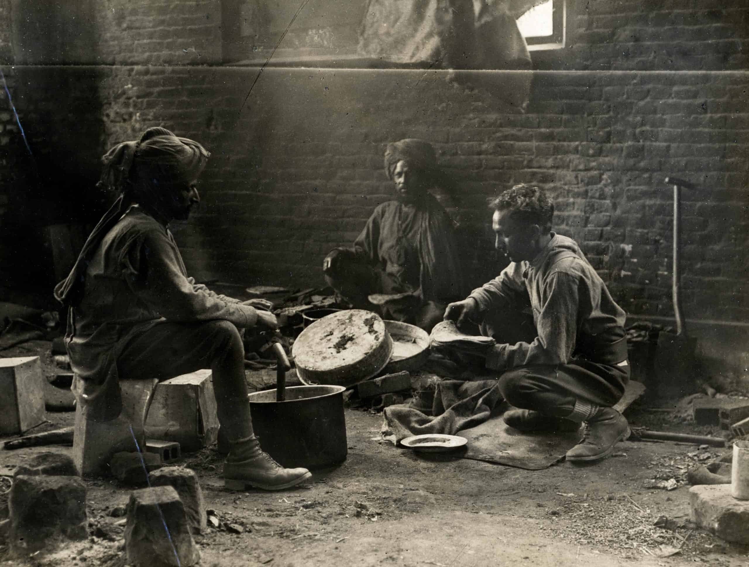 World War 1. Some Indian cavalry troopers preparing a meal
